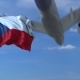 Commercial Airplane Landing Behind Waving Czech Flag