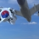 Commercial Airplane Landing Behind Waving Korean Flag - VideoHive Item for Sale