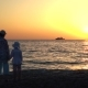 Mother and Child Silhouettes and Sunset Over the Sea - VideoHive Item for Sale