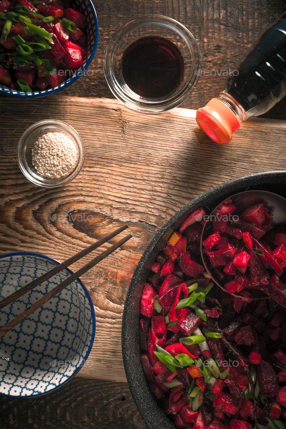 Vegetables in Chinese, soy sauce and a bowl on a wooden table - Stock Photo - Images