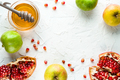 Frame of pomegranate, pomegranate seeds and apples with honey for the Rosh Hashanah - PhotoDune Item for Sale