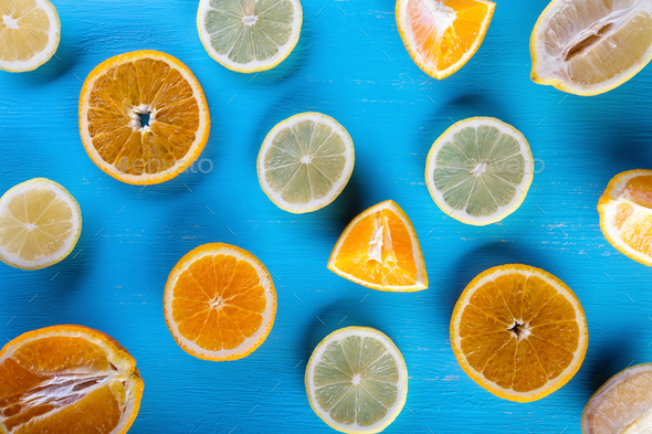 Blue background filled with sliced fruit - Stock Photo - Images
