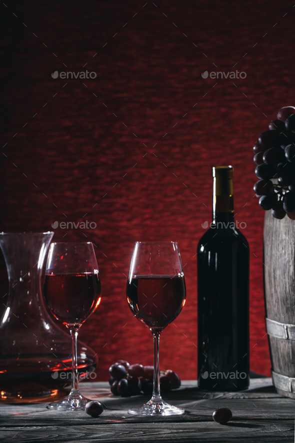 Wine still life with wine in glasses and grapes on a wooden tabl - Stock Photo - Images