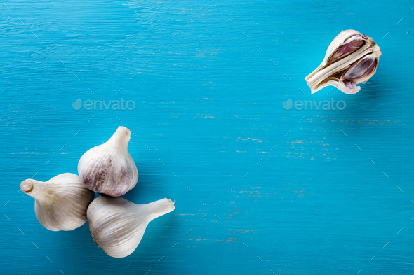 Three heads and cloves of the garlic on a wooden table - Stock Photo - Images