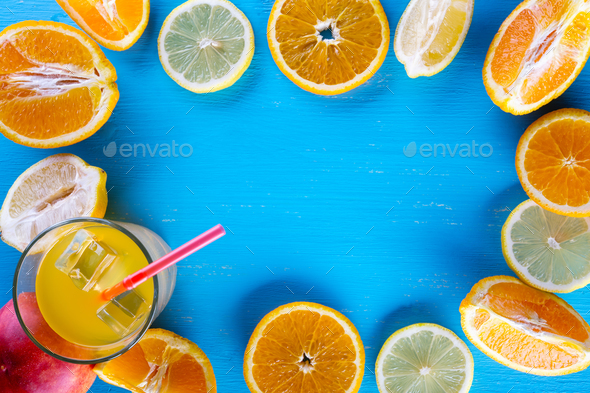Fresh sliced fruit on a wooden blue background - Stock Photo - Images