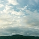 The Clouds Are Moving in Opposite Directions Over the Mountain - VideoHive Item for Sale