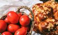 Easter eggs and greek tsoureki on a table