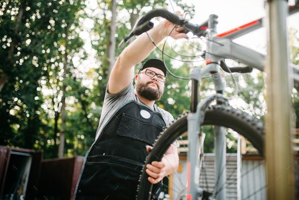 Bicycle mechanic repair bike, top view - Stock Photo - Images