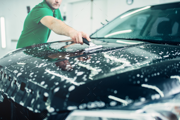 Specialist prepares car for protect against chips - Stock Photo - Images