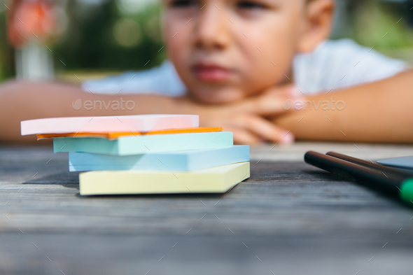 Close-up of stationery and schoolboy - Stock Photo - Images