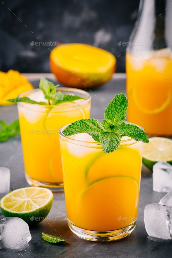 Fresh summer mango cocktail with lime and mint - Stock Photo - Images