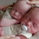 Twin Babies Sleep in the Crib in Dresses - VideoHive Item for Sale