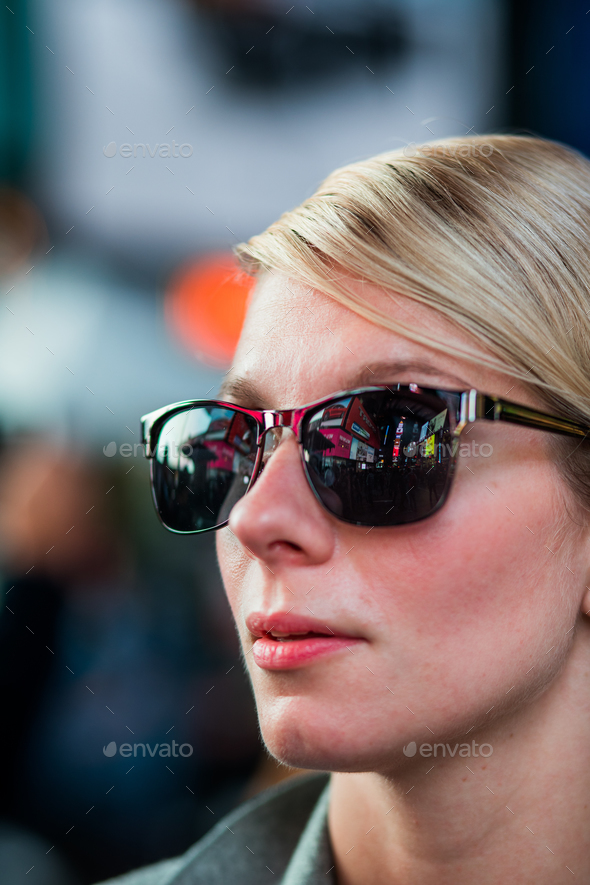 Woman with Time Square Buildings Reflection in Sunglasses at Nig - Stock Photo - Images