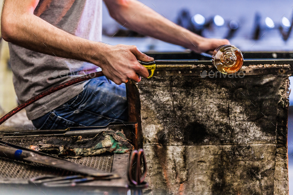 Man Hands Closeup Working on a Blown Glass Piece - Stock Photo - Images