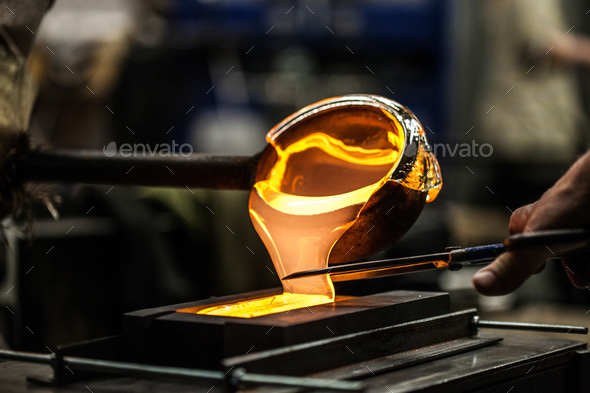 Pouring Melted Glass into Graphite Mold - Stock Photo - Images