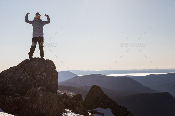 Victorious Woman Enjoying the Success of the Richardson Mountain - Stock Photo - Images