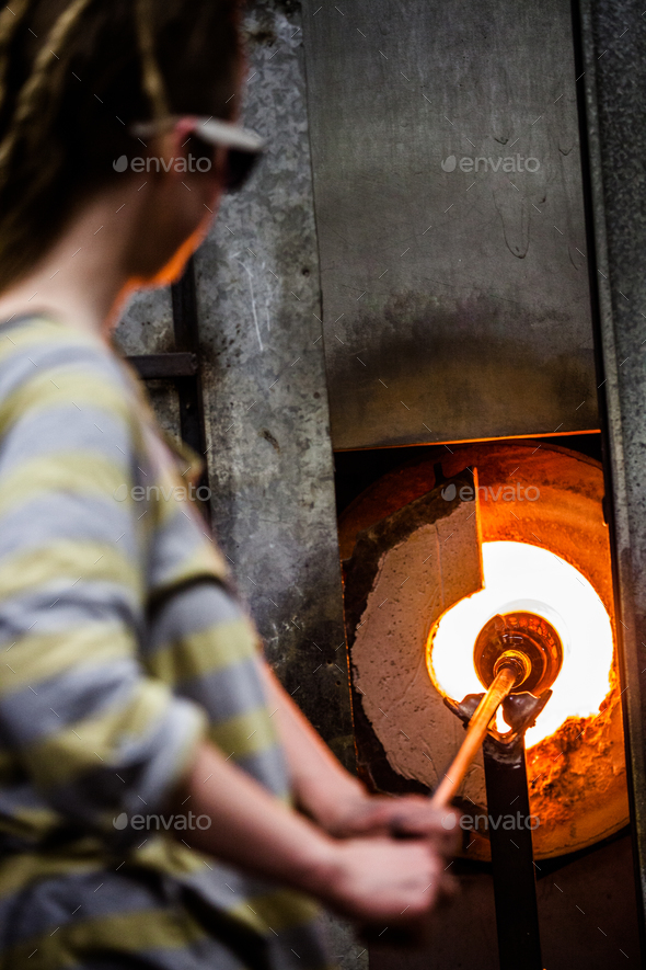 Glassmaker Flashing Piece of Glass in the Kiln - Stock Photo - Images