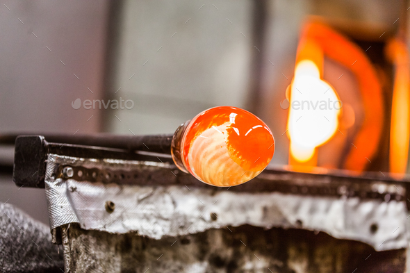 Glassblowing Piece and Furnace in Background - Stock Photo - Images