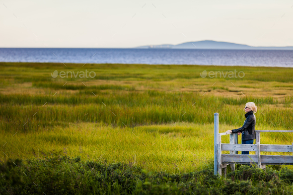 Lonely Young Woman Looking at the Amazing Calm Landscape from a - Stock Photo - Images