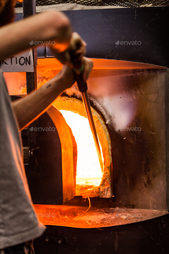 Glassmaker Picking Melted Piece of Glass in the Furnace with Pip - Stock Photo - Images