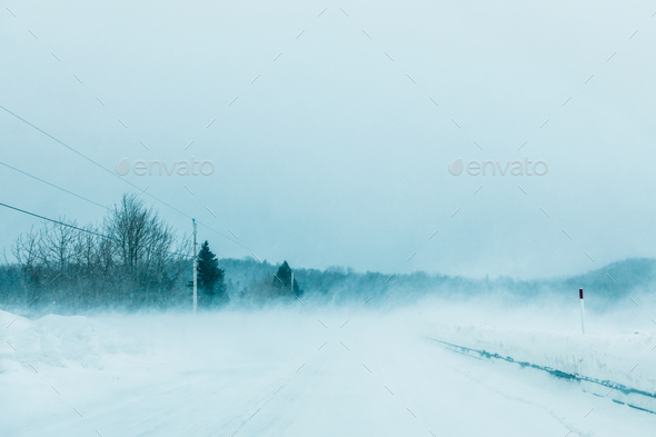 Crazy Snowstorm and Blowing Snow on the road in Canada - Stock Photo - Images
