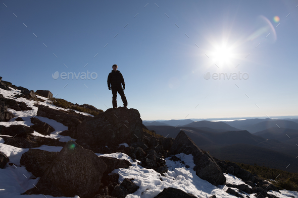 Victorious Man Enjoying the Success of the Richardson Mountain's - Stock Photo - Images
