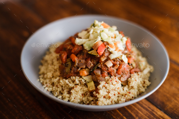 Vegan Dinner composed of Quinoa, Tomato sauce with Vegetables - Stock Photo - Images