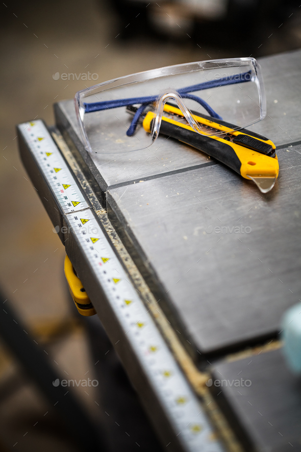 Protective Glasses and Utility Knife - Stock Photo - Images