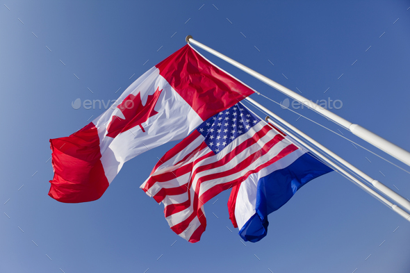 Flags on a sky background - Stock Photo - Images