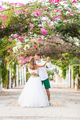 Bride and groom on a romantic moment on nature. Stylish wedding couple outdoors