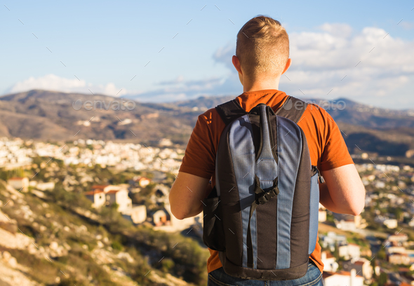 Hiker walks alone. Travel and adventures concept. - Stock Photo - Images