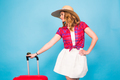 Pretty woman and red suitcase. Beauty, fashion, travel and people concept