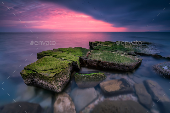 Sea rocks at sunset - Stock Photo - Images