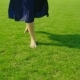Barefooted Female Legs Walking on Green Grass - VideoHive Item for Sale