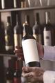 hands selling wine in winestore