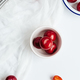 Vertical View of Fresh Plums Scattered on Table - PhotoDune Item for Sale