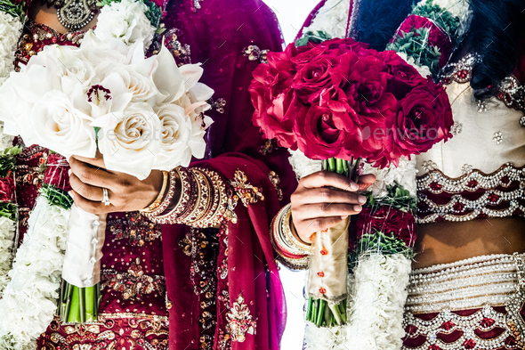Two Indian Wedding Bouquets and brides - Stock Photo - Images