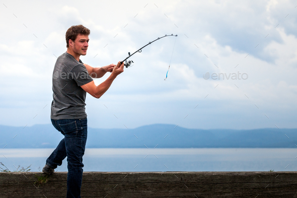 Young Fisherman ready to Swing the Bait to Catch Mackerel - Stock Photo - Images
