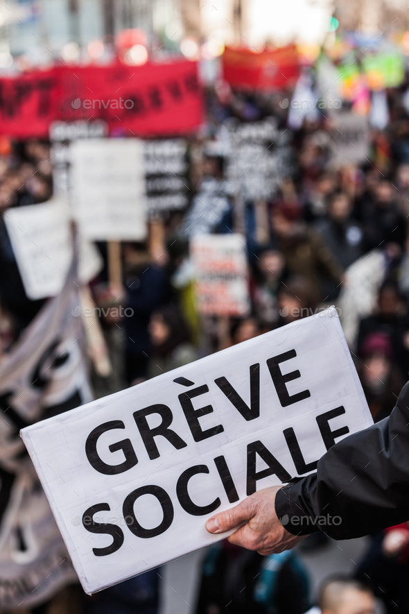 "Someone Holding a Sigh Saying ""Greve Sociale"" (French) with Blu - Stock Photo - Images"