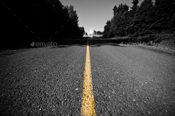 Empty road with Yellow Dividing line at Night - Stock Photo - Images