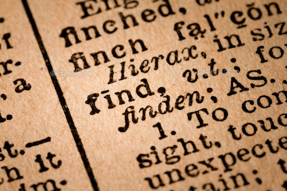 Close-up of an Opened Dictionary showing the Word FIND - Stock Photo - Images