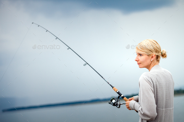 Young Woman Fishing Mackerel in Vacation - Stock Photo - Images