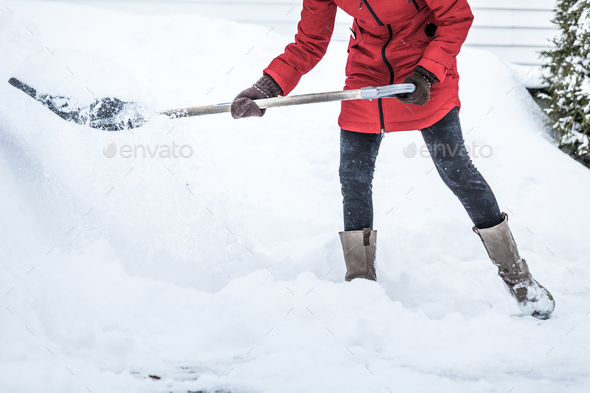 Close-up of Woman Shoveling her Parking lot - Stock Photo - Images