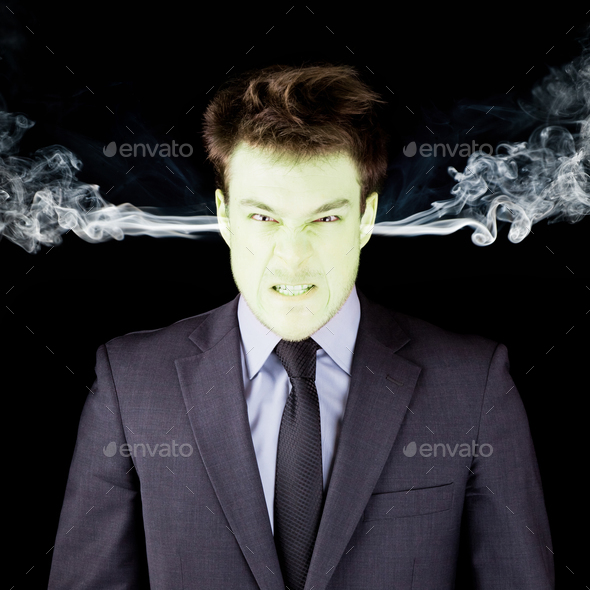 Furious businessman getting green face - Stock Photo - Images