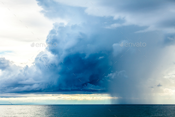 Rain Clouds at the Sea Horizon - Stock Photo - Images