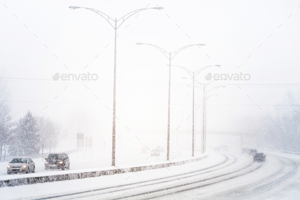 Disturbing Sunset Light and Snowstorm on Highway - Stock Photo - Images