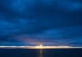 Sunset over Ocean on a Dark Cloudy Evening - PhotoDune Item for Sale