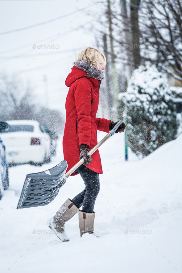 Woman Shoveling her Parking Lot - Stock Photo - Images