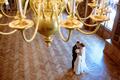 Wedding couple indoors is hugging each other