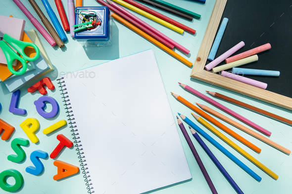 Notepad and blackboard with pencils - Stock Photo - Images